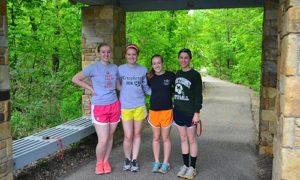 Four Girls Getting Ready to Run