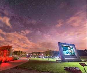 People Watching Outdoor Movie Under Dark Sky at Observatory Park